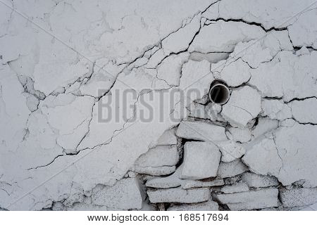 Old Pipe And Cracked White Plaster Wall
