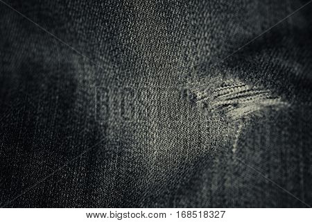 Worn Denim Jean Hole In Black And White