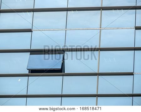 the glass font of a modern building with offices in barcelona, spain
