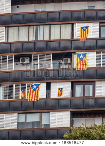 house in barcelona. windows adorned the catalan flags