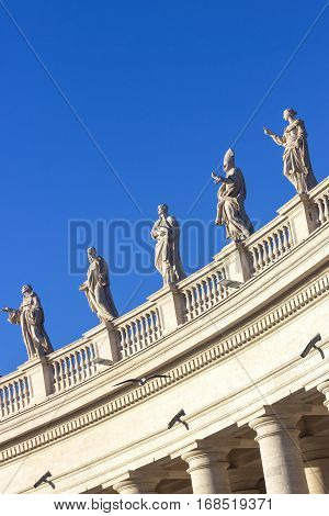 Statues. Famous colonnade of St. Peter's Basilica in Vatican, Rome, Italy