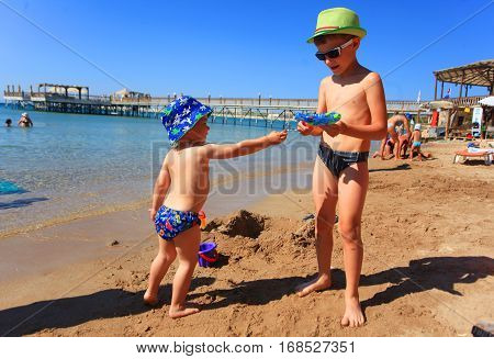 DIDIM TURKEY - JULY 9 2014. Boys playing with toys on the sea.