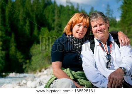 a senior couple is hiking in berchtesgaden bavaria, germany
