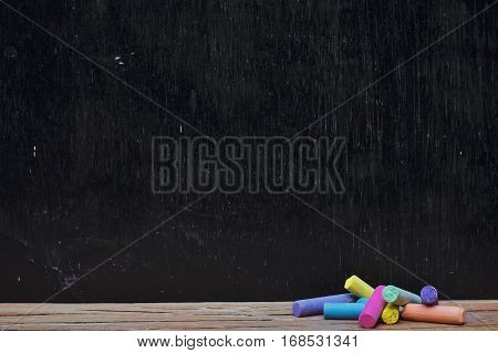 Multicolor chalk on wooden with backboard for education background