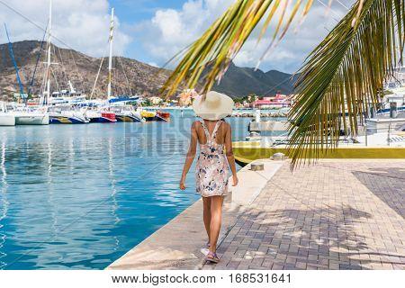 Woman tourist walking in Philipsburg harbor, St Maarten, popular port of call for cruise ship travel destination. Netherlands Antilles.