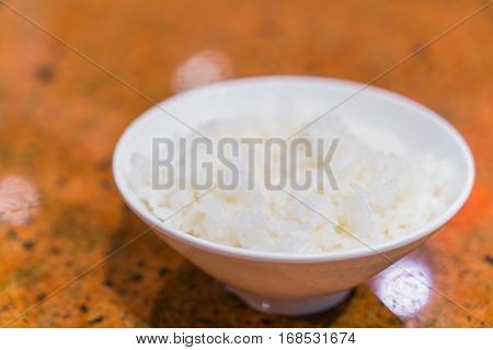 Steamed white rice in cup on  table