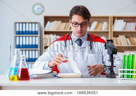 Superhero doctor working in the hospital lab