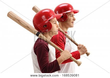 Profile shot of a little boy and a guy with baseball bats and helmets isolated on white background