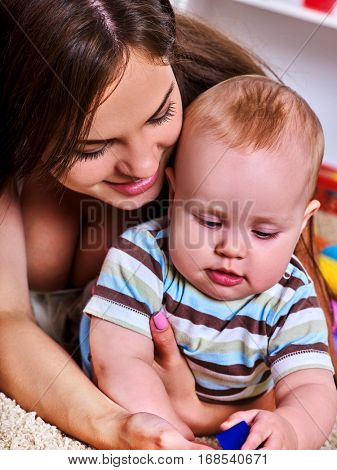 Mother and child playing . Baby boy with mama have fun at home. Family portrait mom and kid son. Parenting and love at an early age.