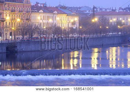 Prague, Czechia - November, 21, 2016: Panorama of an old Prague, bridges and embankment of Vitava river in an evening, Czechia