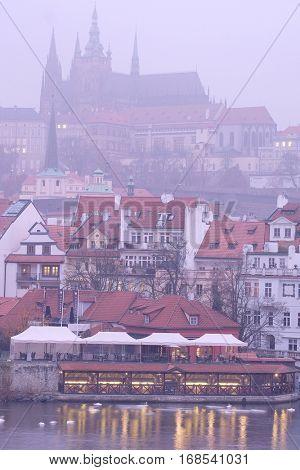 Prague, Czechia - November, 21, 2016: Panorama of an old Prague, bridges and embankment of Vitava river, Czechia in a night