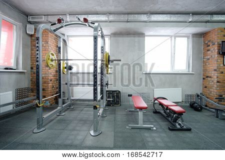 The image of wights in a fitness hall
