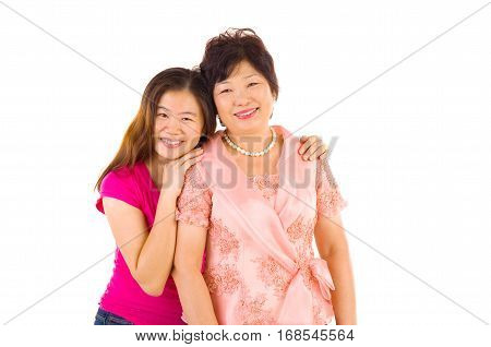 Asian mother and daughter. Happy Asian family mother and adult offspring having fun time at indoor studio.
