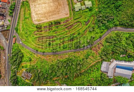 Overall Aerial View Of Small Green Fields In Banos De Agua Santa Latin American Town Tungurahua Province In The Daylight South America