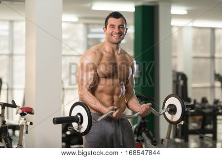 Biceps Exercise With Barbell In A Fitness Center