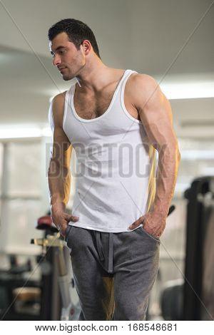 Man In Undershirt Flexing Muscles