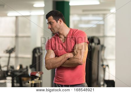 Strong Man In Pink T-shirt Background Gym