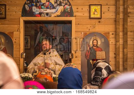 Dobrush Belarus - May 1 2016: The priest prays to his parishioners during Easter