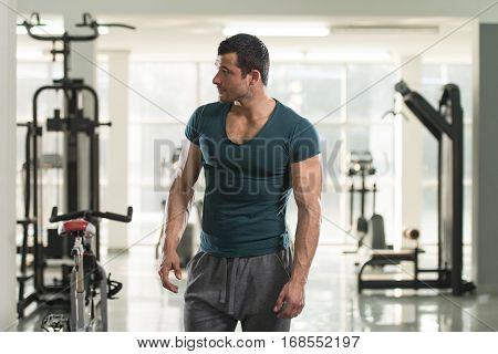 Portrait Of Muscle Man In Green T-shirt