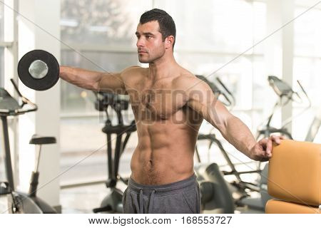 Hairy Man With Dumbbells Exercising Shoulders