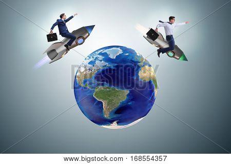 Two businessmen chasing around globe