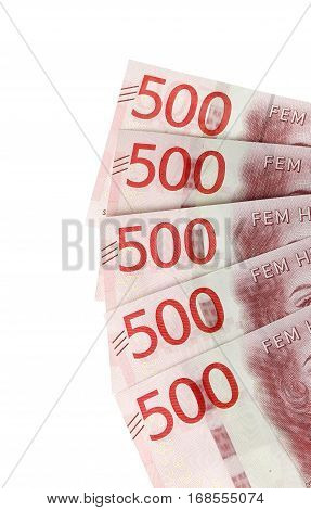 Left most part of five Swedish five hundred krona banknotes isolated on white background.