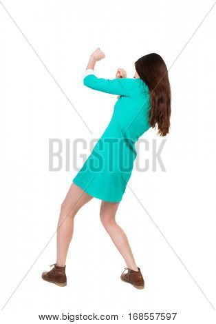 skinny woman funny fights waving his arms and legs. Isolated over white background. The girl in a dress beats foot in brown shoe. The girl in a green dress simply evade attacks.