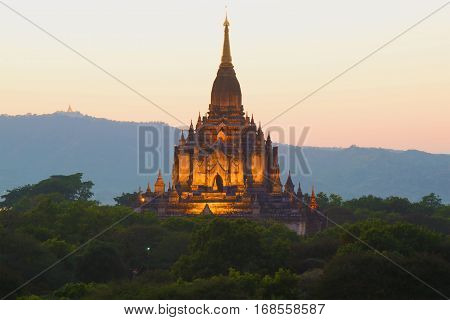 Top of the ancient Buddhist temple of Gawdaw Palin in evening twilight. Bagan, Myanmar