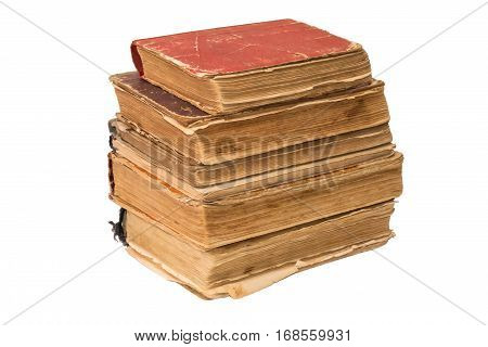 A stack of old tattered books. Vintage torn books. Antiques isolated