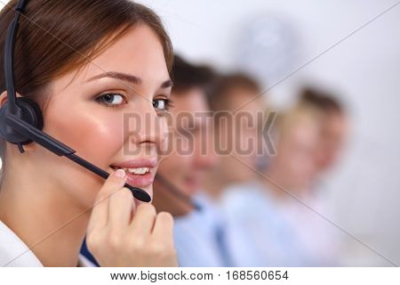 Smiling positive young businesspeople and colleagues in a call center office