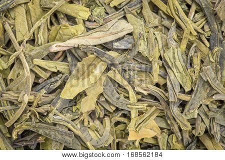 background texture of loose leaf dragonwell green tea (Longjing)