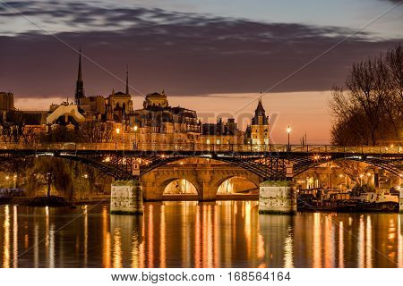 Sunrise on Ile de la Cite with the Pont des Arts Pont Neuf and the Seine River. 1st Arrondissement Paris France