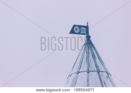 Brick round corner tower with a spire