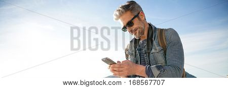 Man with sunglasses using smartphone, template