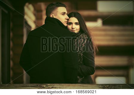 Happy young couple on the porch of cottage  Stylish fashion model outdoor