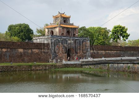 HUE, THAILAND - DECEMBER 15, 2015: Ancient gate of a citadel of the Hue city in the cloudy afternoon. Vietnam