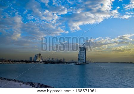 Sunset at Burj Al Arab and Jumeirah Beach Hotels in Dubai United Arab Emirates