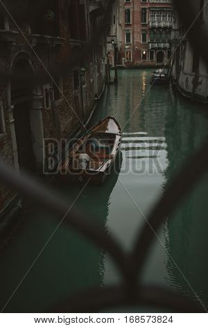Venice Italy - February 23 2014: Venice Italy. Water canal in Venice with boats and gondolas