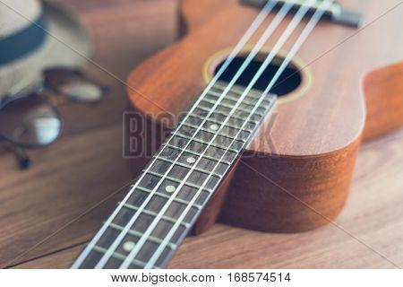 Ukulele guitar on wooden table Vintage tone