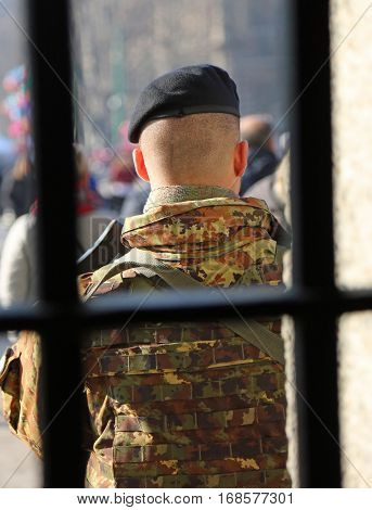 Soldier With Camouflage Uniform Outside A Prison