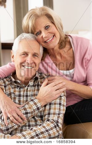 Happy Senior Couple Relaxing At Home