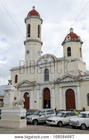 Cienfuegos Cuba - 18 january 2016: people walking in front of Cathedral at Cienfuegos on Cuba