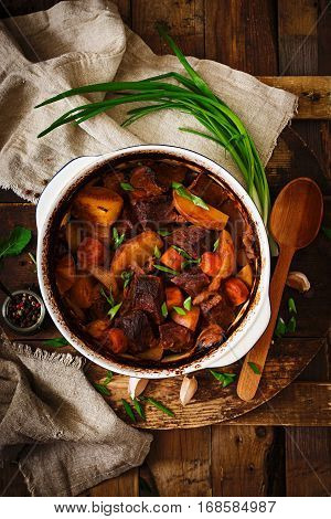 Baked Potato With Beef Bourguignon On The Old Wooden Background In Rustic Style. Flat Lay. Top View