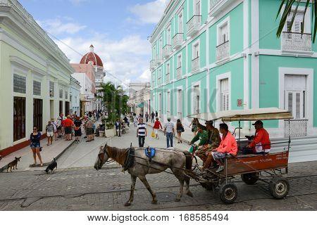 Cienfuegos Cuba - 18 january 2016: people walking on the pedestrian street of Cienfuegos on Cuba