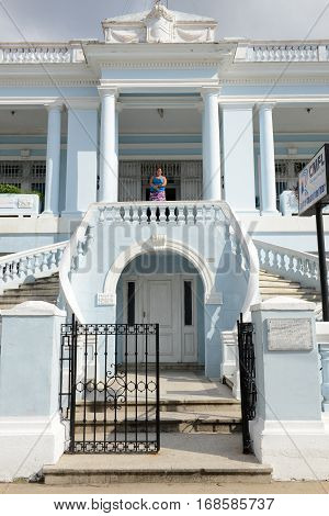 Cienfuegos Cuba - 18 january 2016: People walking down the stairs of a colonial mansion at the old town of Cienfuegos Cuba