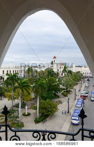 Cienfuegos Cuba - 18 january 2016: people walking on Jose Marti park with Town Hall and Cathedral of Cienfuegos on Cuba