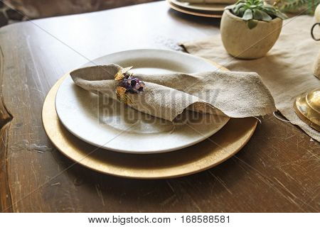 expensive plates of gold and natural napkins, retro style, vintage, aristocratic manners