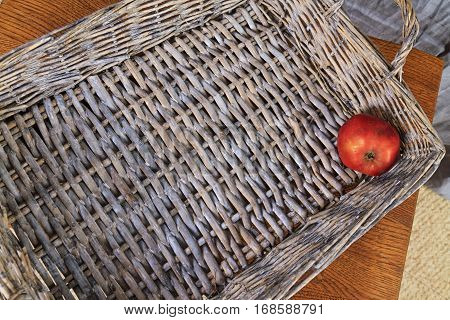 red apple lying on the bottom of wooden box, last residue fruit basket, vintage