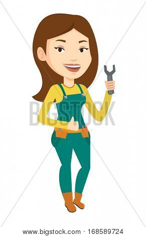 Young repairman standing with a spanner in hand. Caucasian female repairman giving thumb up. Female repairman in overalls holding spanner. Vector flat design illustration isolated on white background.