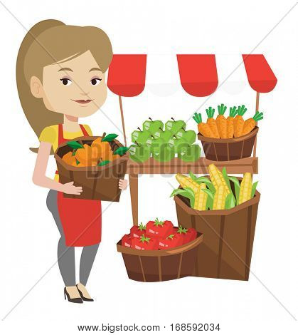 Greengrocer standing near stall with fruits and vegetables. Greengrocer standing near market stall. Greengrocer holding basket with fruits. Vector flat design illustration isolated on white background